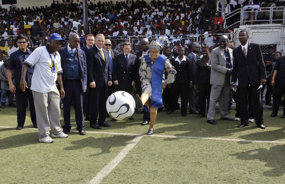 Ellen Johnson-Sirleaf, President of Liberia, kicks a soccer ball to mark the start of the event