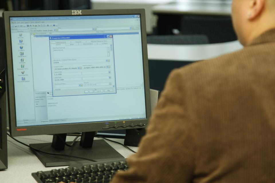 A staff member researching the database at the UN Archives and Records Management  Section (ARMS).